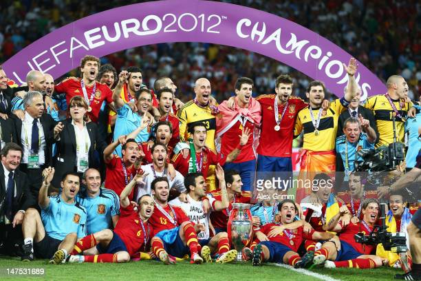 Spain players and coaching staff celebrate with the trophy following victory in the UEFA EURO 2012 final match between Spain and Italy at the Olympic...