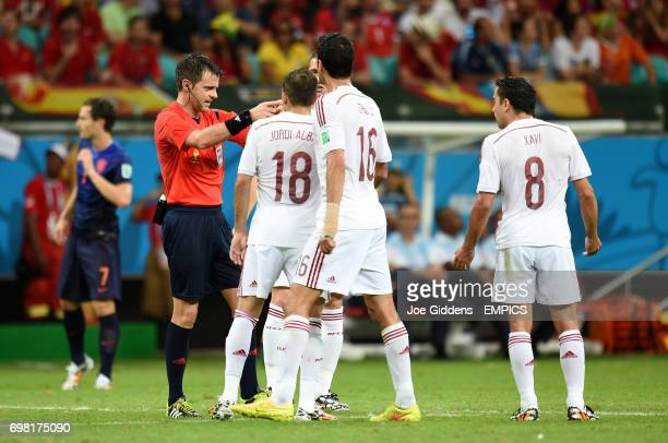 Spain players appeal to referee Nicola Rizzoli after Netherland's' Stefan de Vrij scores his side's third goal
