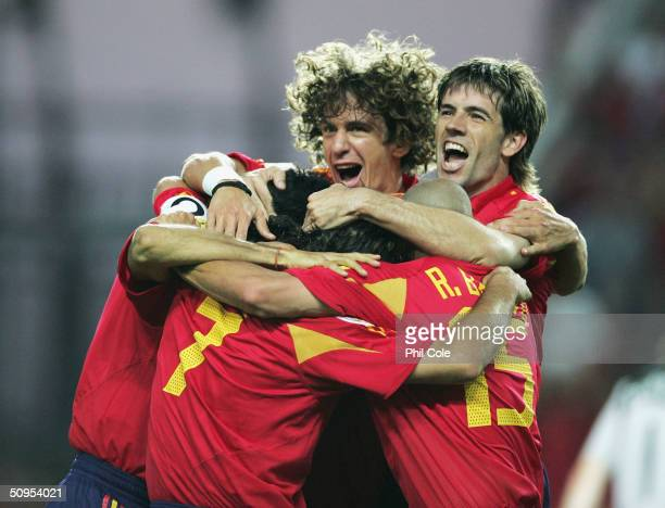 Spain players congratulated Juan Carlos Valeron of Spain after he scores their first goal during the Spain v Russia Group A match in the 2004 UEFA...