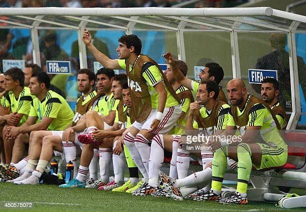 Spain players on the bench react during the 2014 FIFA World Cup Brazil Group B match between Spain and Netherlands at Arena Fonte Nova on June 13...