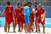 Spain players shake hands prior to the Men's beach Soccer classification 56 match between Ukraine and Spain on day sixteen of the Baku 2015 European...