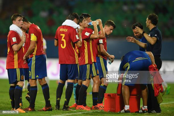 Spain players try and cool down during a water break in the FIFA U17 World Cup India 2017 group D match between Spain and Korea DPR at the Jawaharlal...