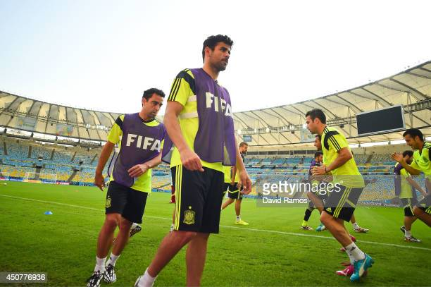 Spain players warm up during a Spain training session ahead of their 2014 FIFA World Cup Group B match against Chile at Maracana on June 17 2014 in...
