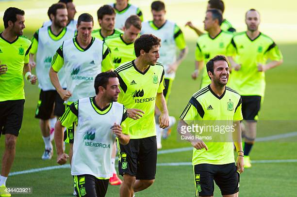 Spain players warm up during a training session ahead of their international friendly match against Bolivia at the Ramon Sanchez Pizjuan stadium on...