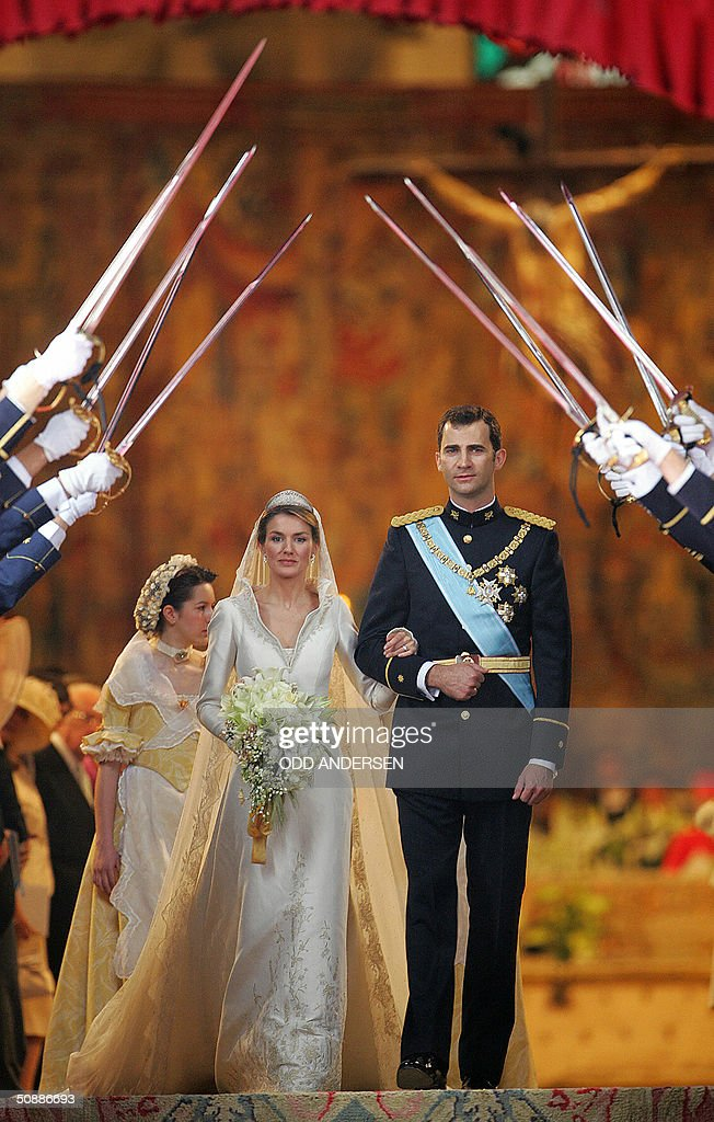 Princess of Asturias Letizia Ortiz and her husband Spanish Crown Prince Felipe of Bourbon smile as they leave Madrid's Almudena Cathedral at the end of their wedding ceremony 22 May 2004. AFP PHOTO POOL ODD ANDERSEN