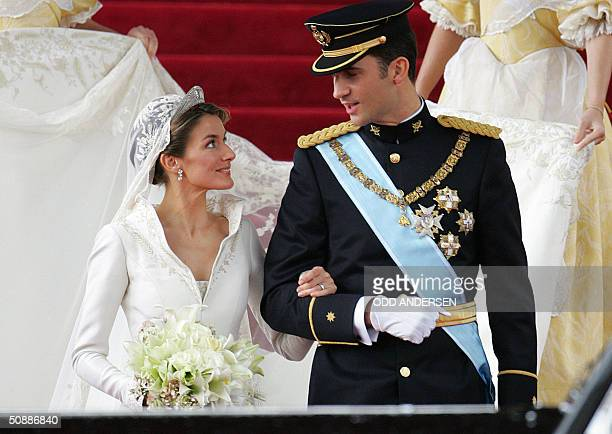 Princess of Asturias Letizia Ortiz and her husband Spanish Crown Prince Felipe of Bourbon smile as they leave Madrid's Almudena Cathedral at the end...