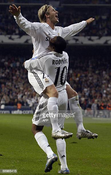 Real Madrid's David Beckham is congratuled by his teammate Robinho afer scoring during their Champions League football match against Rosenborg at the...