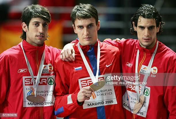Russian gold medalist Dmitriy Bogdanov poses next to Spanish silver medalist Antonio Manuel Reina and bronze medalist Juan De Dios Jurado after the...