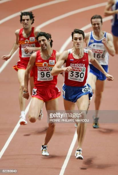 Russian gold medalist Dmitriy Bogdanov runs infront of Spanish Antonio Manuel Reina and bronze medalist Juan De Dios Jurado after the men's 800m...