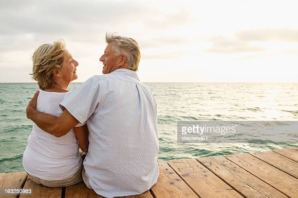 Spain, Senior couple embracing at the sea