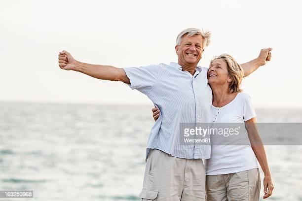 Spain, Senior couple having fun at the sea