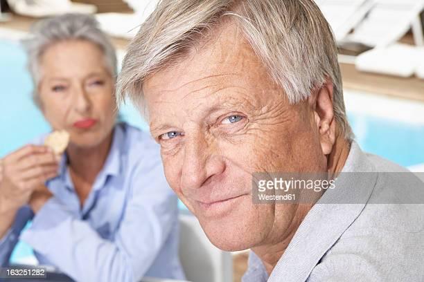 Spain, Senior couple having lunch at Mallorca