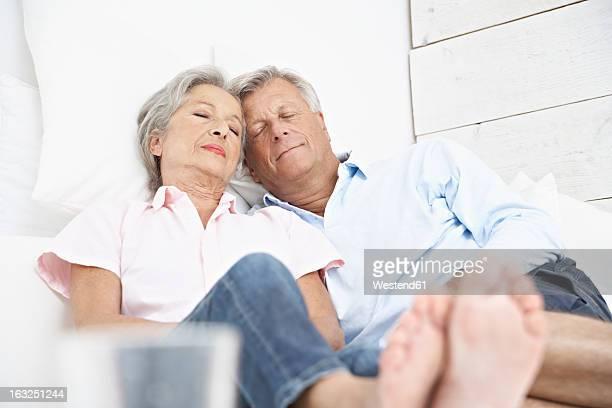 Spain, Senior couple sleeping on bed in hotel