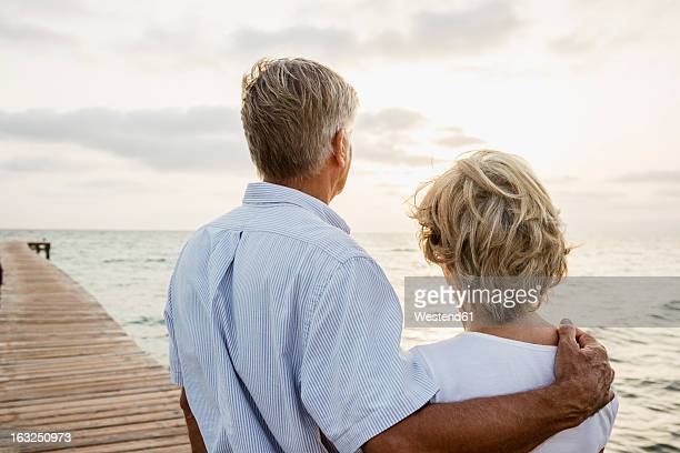 Spain, Senior couple standing at the sea