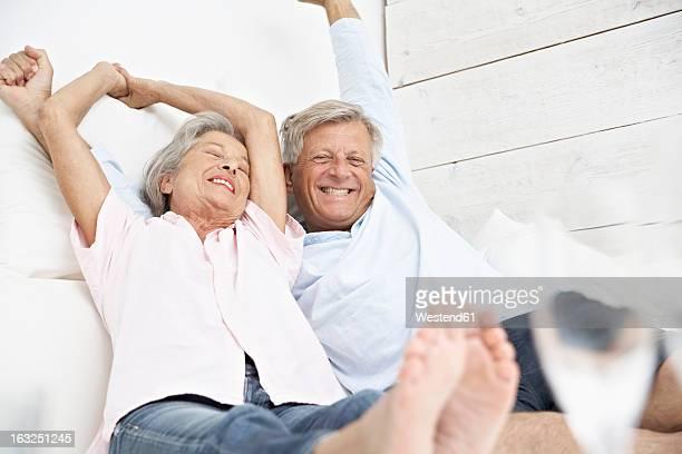 Spain, Senior couple waking up, smiling