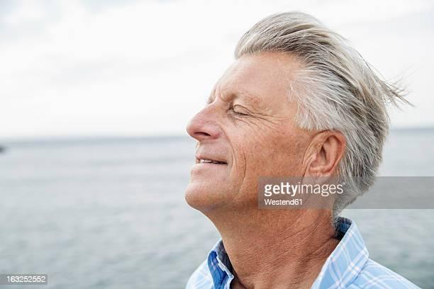 Spain, Senior man with closed eyes, close up