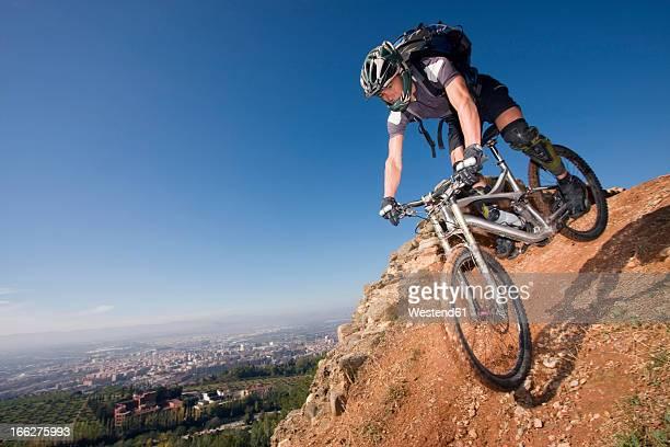 Spain, Sierra Nevada, Granada, Man mountain biking downhill