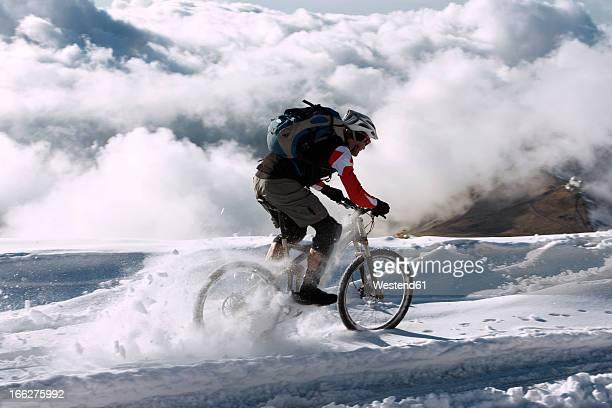 Spain, Sierra Nevada, mountain biking across snow