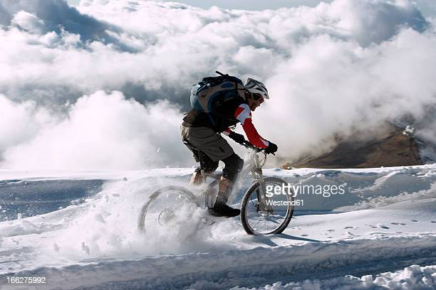 Spain, Sierra Nevada, mountain biking across snow