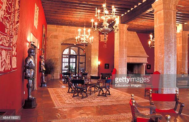 Spain Siguenza Interior Of Castle Parador With Chandeliers And Suits Of Armor