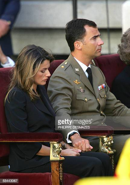 Spain's Princess Letizia and husband Prince Felipe are seen during the state funeral of the 17 Spanish soldiers who died in Afghanistan 20 August...