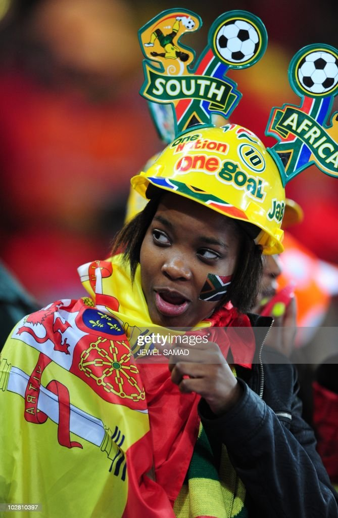 A Spain supporter wearing a Makarapa cheers prior to the start of the 2010 World Cup football final Netherlands vs Spain on July 11 2010 at Soccer...