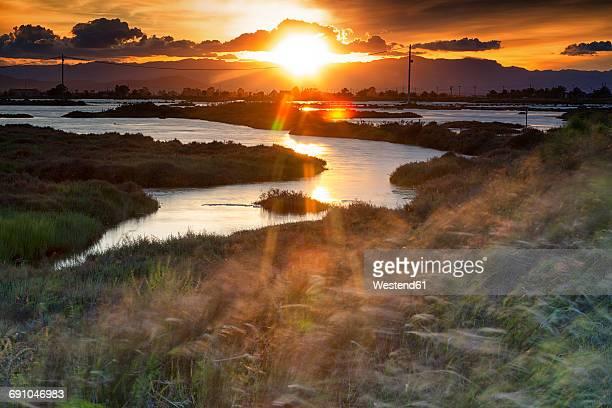 Spain, Tarragona, Ebro Delta, Tancada lagoon at sunset