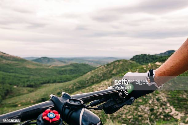 Spain, Tarragona, Mountain biker in extreme terrain, close up of handle bar
