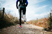 Spain, Tarragona, Woman running