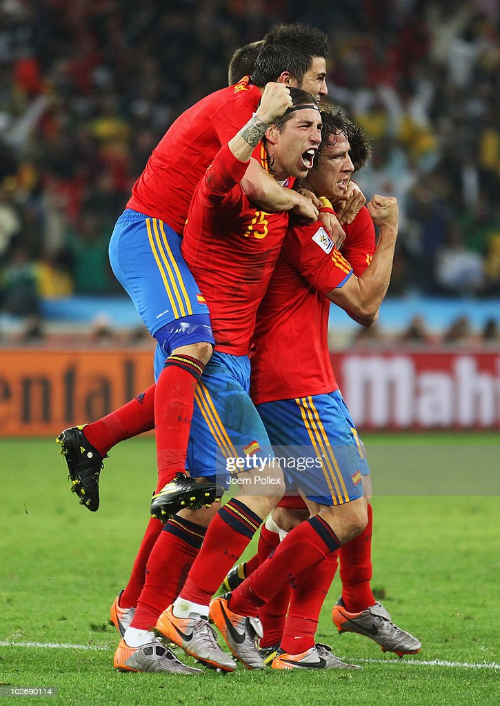 Spain team mates celebrate the opening goal by <a gi-track='captionPersonalityLinkClicked' href=/galleries/search?phrase=Carles+Puyol&family=editorial&specificpeople=211383 ng-click='$event.stopPropagation()'>Carles Puyol</a> during the 2010 FIFA World Cup South Africa Semi Final match between Germany and Spain at Durban Stadium on July 7, 2010 in Durban, South Africa.
