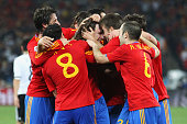 Spain team mates celebrate the opening goal by Carles Puyol during the 2010 FIFA World Cup South Africa Semi Final match between Germany and Spain at...