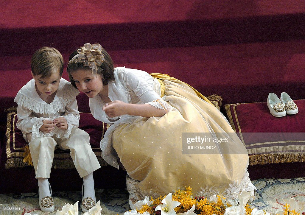 two children attend the wedding ceremony of Spanish crown prince Felipe and Letizia Ortiz in Madrid 22 May 2004.