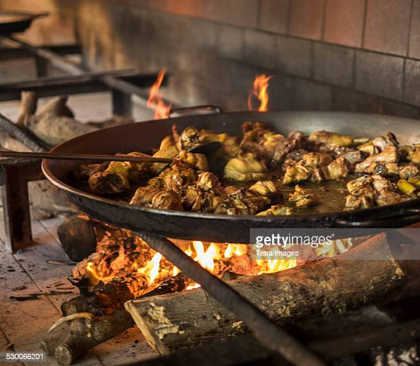 Spain, Valencia, Paella on open fire stove