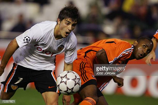 Valencia's David Villa fights for the ball with Shakhtar Donetsk's Brazilian Leonardo during their Group D Champions League football match at the...