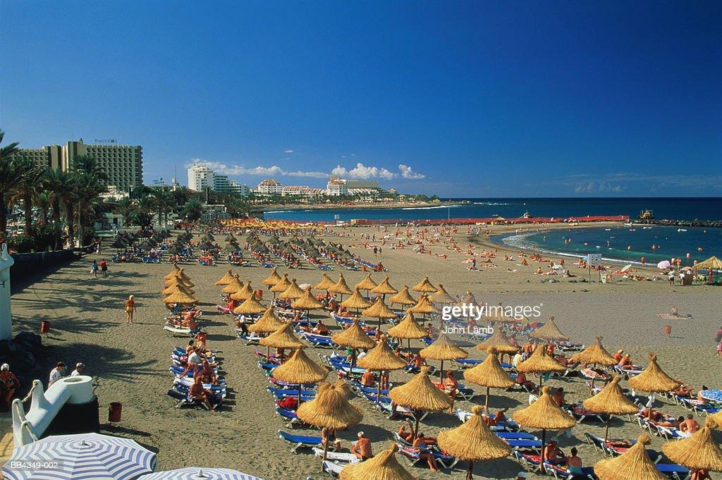 Spain,Canary Islands,Tenerife,Playa de las Americas,tourists on beach