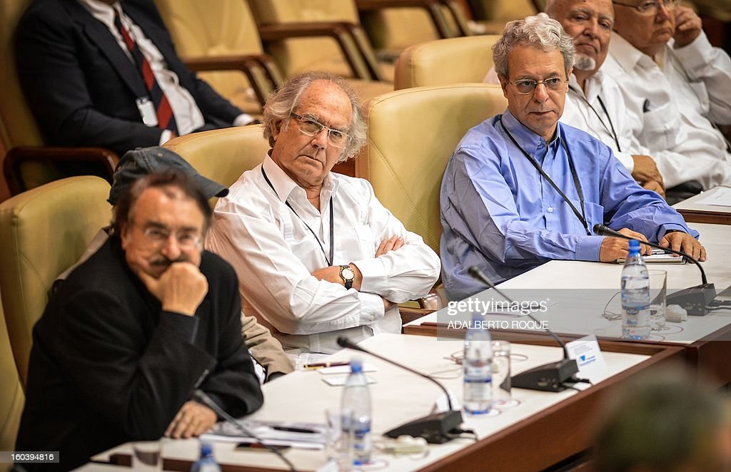 Spain-French journalist Ignacio Ramonet, Nobel Prize lauretae Argentine Adolfo Perez Esquivel and Brazilian theologian Frei Betto listen to the speech by Brazilian former President Luiz Inacio Lula da Silva (not in frame) during the 3rd International Conference for World Balance, at Havana's Convention Center, on January 30, 2013. AFP PHOTO/ADALBERTO ROQUE