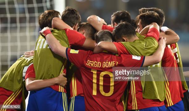 Spainish players celebrate after scoring a goal during the second semi final football match between Mali and Spain in the FIFA U17 World Cup at the...