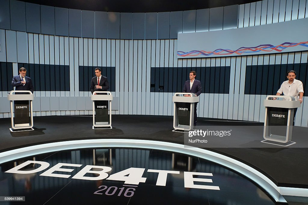 Spain's acting Prime Minister and Popular Party candidate Mariano Rajoy, left, leader of Socialist Party Pedro Sanchez, center left, Ciudadanos (Citizens) Party leader Albert Rivera, center right, and Podemos Party leader Pablo Iglesias, before the start of a live televised electoral debate in Madrid, Spain, Monday, June 13, 2016.