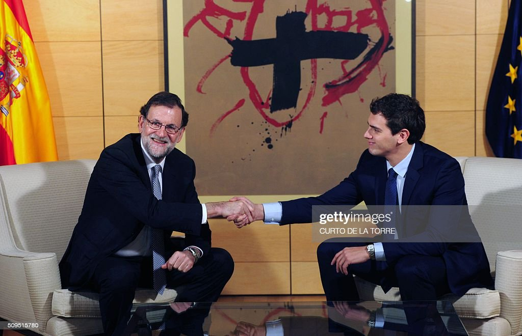Spain's acting Prime Minister Mariano Rajoy (L) and leader of center right party Ciudadanos Albert Rivera pose before a meeting at the Spanish parliament in Madrid on February 11, 2016. Spain has been plunged in political uncertainty since December 20 elections put an end to the long-established two-party, conservative-socialist system with the emergence of Podemos and Ciudadanos, resulting in a parliament fractured along four main groupings that makes any government formation difficult. TORRE