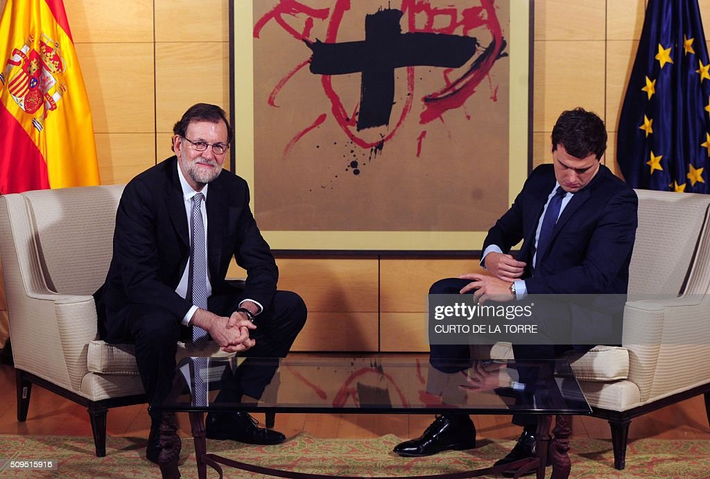 Spain's acting Prime Minister Mariano Rajoy (L) and leader of center right party Ciudadanos Albert Rivera sit before a meeting at the Spanish parliament in Madrid on February 11, 2016. Spain has been plunged in political uncertainty since December 20 elections put an end to the long-established two-party, conservative-socialist system with the emergence of Podemos and Ciudadanos, resulting in a parliament fractured along four main groupings that makes any government formation difficult. TORRE