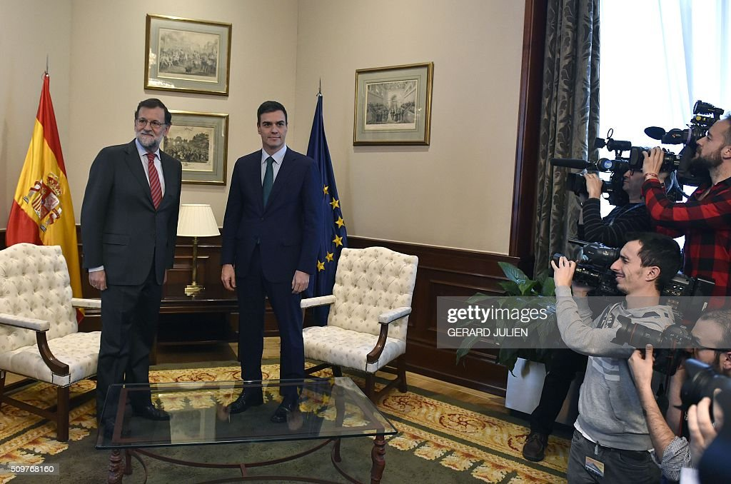 Spain's acting Prime Minister Mariano Rajoy and Spanish Socialist Party (PSOE) leader Pedro Sanchez (R) pose before a meeting at the Spanish parliament in Madrid on February 12, 2016. Spain has been plunged in political uncertainty since December 20 elections put an end to the long-established two-party, conservative-socialist system with the emergence of Podemos and Ciudadanos, resulting in a parliament fractured along four main groupings that makes any government formation difficult. / AFP / GERARD JULIEN