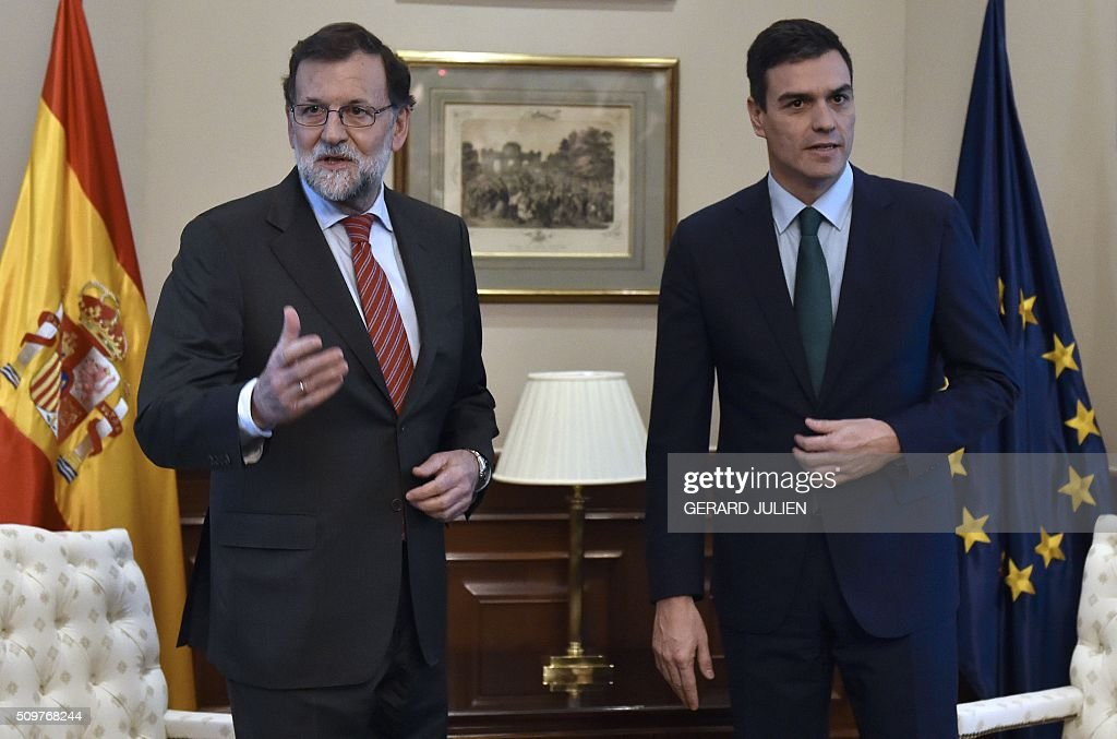 Spain's acting Prime Minister Mariano Rajoy and Spanish Socialist Party (PSOE) leader Pedro Sanchez (R) stand before a meeting at the Spanish parliament in Madrid on February 12, 2016. Spain has been plunged in political uncertainty since December 20 elections put an end to the long-established two-party, conservative-socialist system with the emergence of Podemos and Ciudadanos, resulting in a parliament fractured along four main groupings that makes any government formation difficult. / AFP / GERARD JULIEN