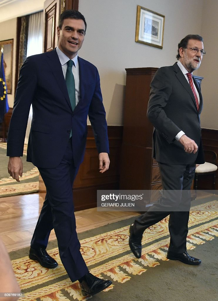 Spain's acting Prime Minister Mariano Rajoy (R) and Spanish Socialist Party (PSOE) leader Pedro Sanchez arrive for a meeting at the Spanish parliament in Madrid on February 12, 2016. Spain has been plunged in political uncertainty since December 20 elections put an end to the long-established two-party, conservative-socialist system with the emergence of Podemos and Ciudadanos, resulting in a parliament fractured along four main groupings that makes any government formation difficult. / AFP / GERARD JULIEN
