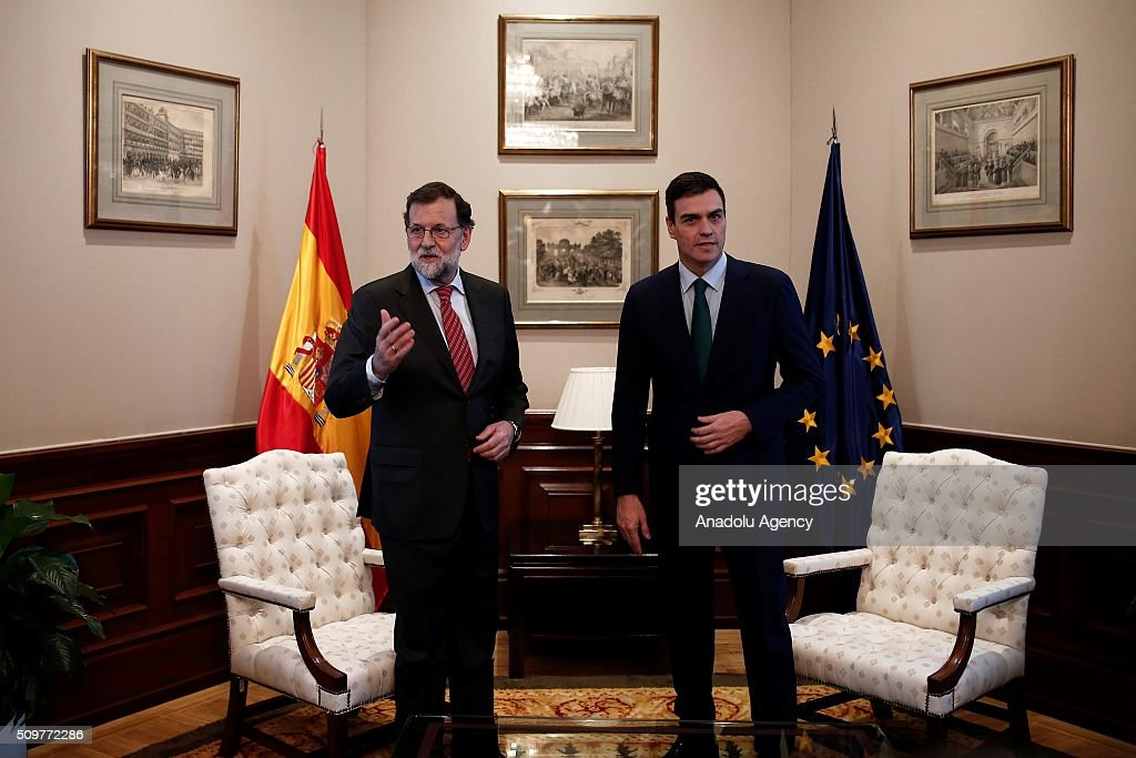 Spain's acting Prime Minister Mariano Rajoy (L) and Spanish Socialist Party (PSOE) leader Pedro Sanchez (R) stand before a meeting at the Spanish parliament in Madrid, Spain on February 12, 2016.