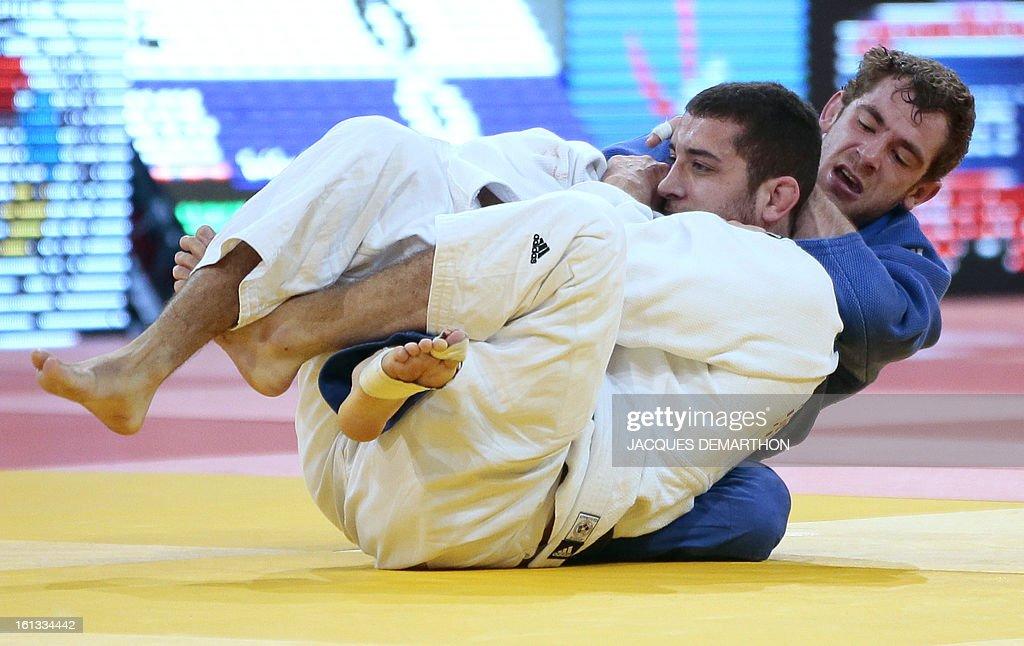 Spain's Adrian Nacimiento Lorenzo (white) fights against Belgium's Joachim Bottieau (blue) on February 10, 2013 in Paris, during the eliminatories of the Men -81kg of the Paris Judo Grand Slam tournament. AFP PHOTO