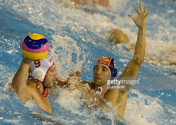 Spain's Albert Espanol vies with Montenegro's Aleksandar Ivovic during the preliminary round match of the men's water polo competition between...