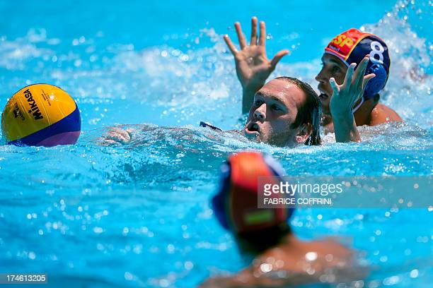 Spain's Albert Espanol vies with US player Alexander Bowen during their men's water polo quarterfinals qualification match at the FINA World...