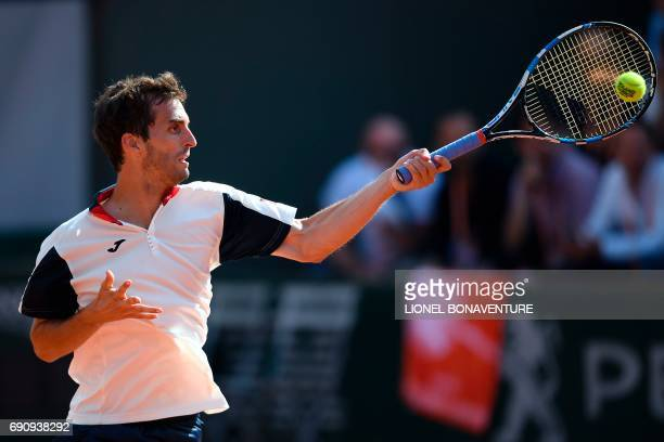 Spain's Albert RamosVinolas returns the ball to France's Benjamin Bonzi during their tennis match at the Roland Garros 2017 French Open on May 31...