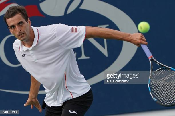 Spain's Albert RamosVinolas returns the ball to Uzbekistan's Denis Istomin during their Men's Singles match at the 2017 US Open Tennis Tournament on...