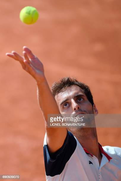 Spain's Albert RamosVinolas serves to France's Benjamin Bonzi during their tennis match at the Roland Garros 2017 French Open on May 31 2017 in Paris...